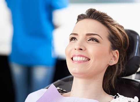 Woman at dental office smiling