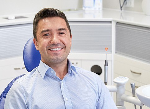 Man at dental office for dental checkup and teeth cleaning