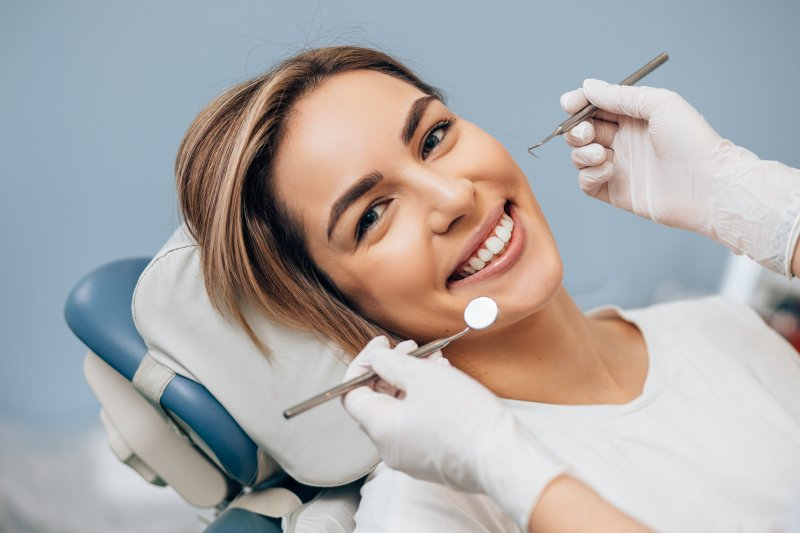 Closeup of woman smiling during dental checkup